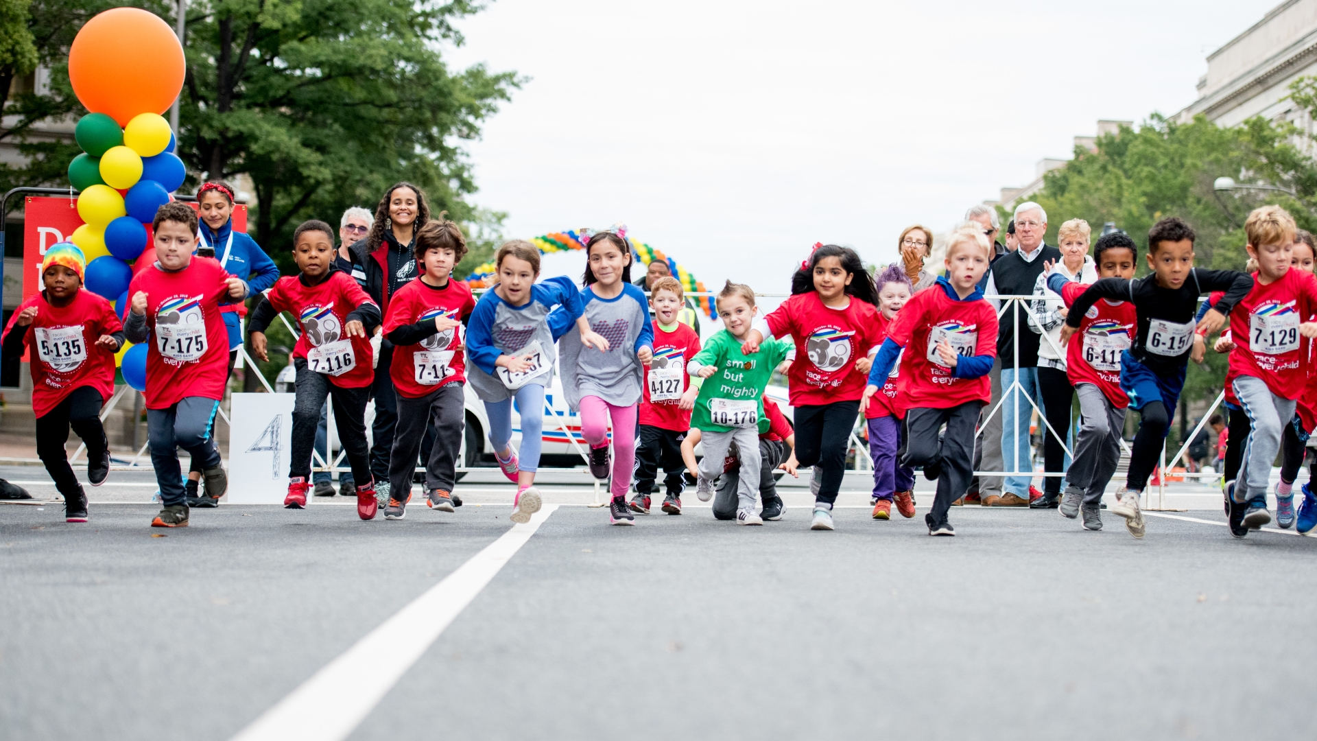 Children running during Race for Every Child